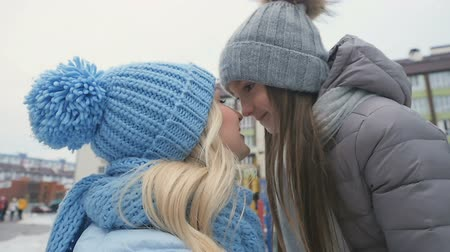 den matek : Happy mother and daughter rubbing noses together outdoors