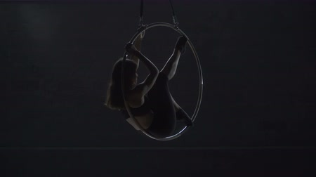 showbiz : Beautiful gymnast make an element man in the moon on aerial hoop