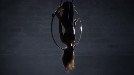 showbiz : Flexible girl hangs upside down in the aerial hoop