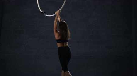 showbiz : Pretty flexible girl makes a gymnastic trick on the aerial hoop