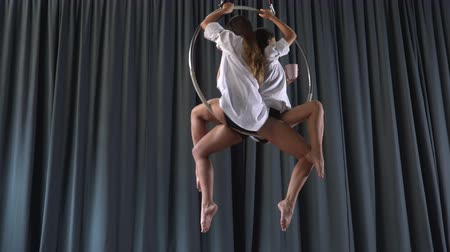 showbiz : Pretty girls spins in the aerial hoop and drinks water