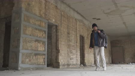 necessity : Sick homeless searches something in abandoned building Stock Footage