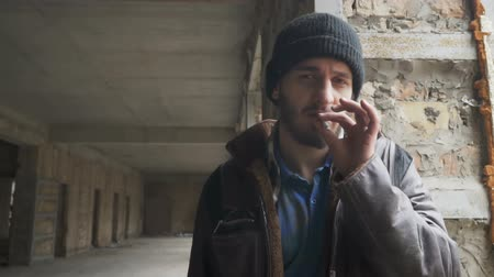 csavargó : Homeless looks in camera and smokes cigarette