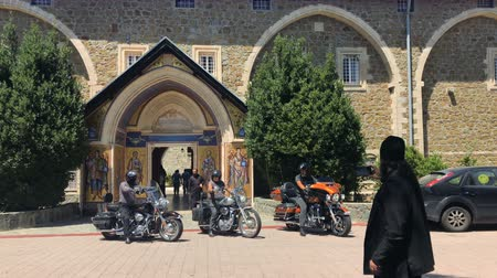 kypr : Bikers on motorcycles near the church