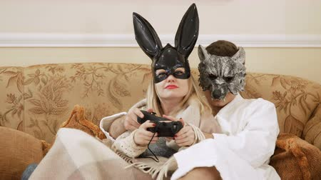 kulaklar : Wolf and rabbit play in game on console with joysticks