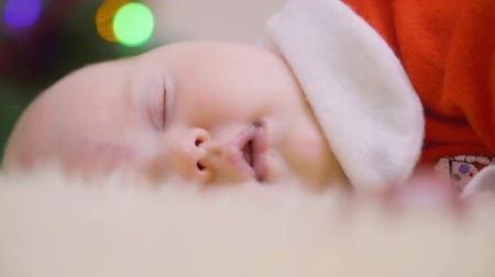 napping : Portrait of adorable sleeping newborn baby girl Stock Footage