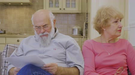 resent : Senior woman takes offense on her husband due to high rent bills Stock Footage