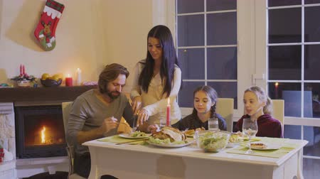 família : Happy family at the christmas table