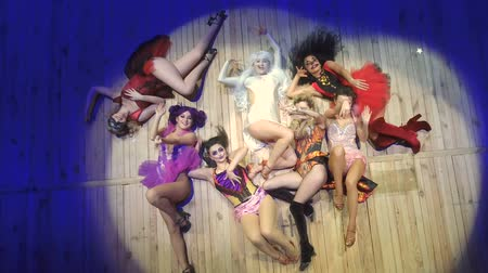 hallucination : Young actors in crazy costumes lays on scene