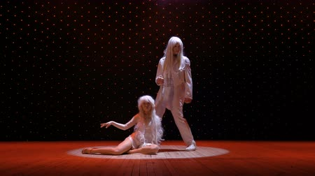 greasepaint : Albino couple in light of spotlight on stage