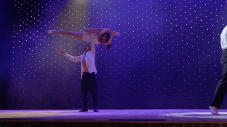 soul : Acrobats performs tricks during young couple sing song, stage of theatre Stock Footage