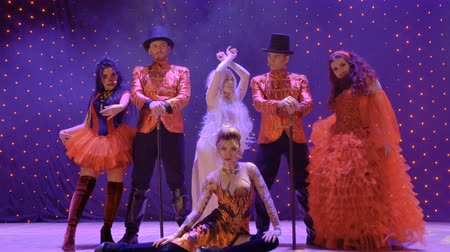 greasepaint : Group of freaks on stage Stock Footage