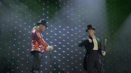 роль : Two handsome gentlemen are dancing on stage