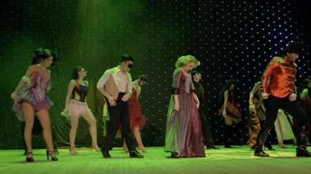 rendkívüli : Group of fairytale heroes are dancing and singing on stage in theatre