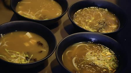 tofu : Chef decorates miso soup with sesame
