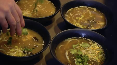 tofu : Chef decorates miso soup with parsley