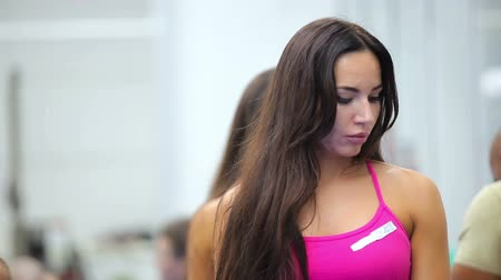 longhair : Beautiful young woman listening a coach on the training in the gym Stock Footage