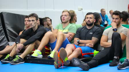 workgroup : Young men listening a trainer on the training in the gym Stock Footage