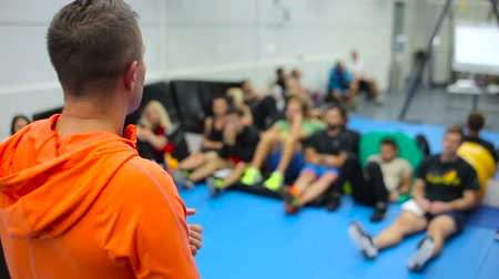 workgroup : The trainer has training in the gym for the young sportsmen
