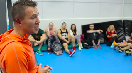 workgroup : Professional trainer spends the training for a young sportsmen in the gym