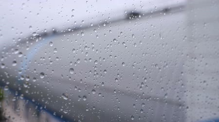 waterdrop : Raindrops flows down on the clear window Stock Footage