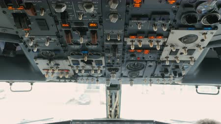 hız göstergesi : Pilot pushes buttons on panel of airplane
