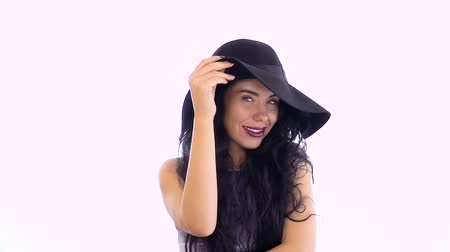 sunhat : Stylish brunette wearing sun-hat and with red lips at white background Stock Footage