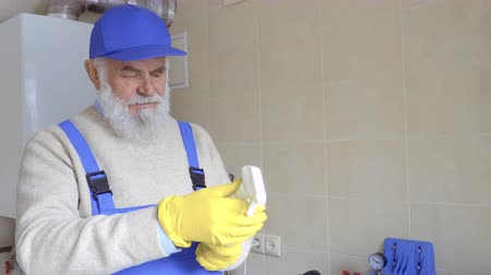 chemical agent : Mature man looks at the instruction of spray