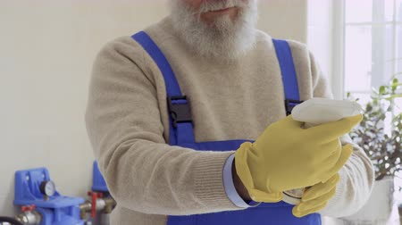 chemical agent : Old man read the instruction of cleaning agent