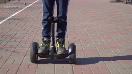 gyroscope : Boy is riding on gyroscope on the road Stock Footage