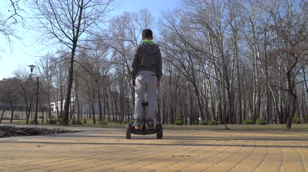segway : Teenager rides on gyroscope in park