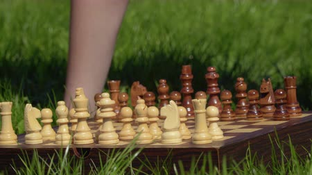 rytíř : Boy put the last piece at chessboard and preparing to game