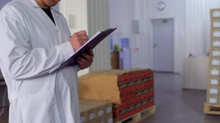 supervisor : Man makes report about working capacity at factory Stock Footage
