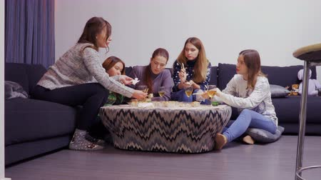 sock : Five girls gathering around the table and eating with chopsticks asian food
