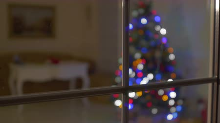 invisible : Christmas tree is lighting in the room through the window in the dark room Stock Footage