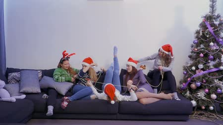 happy socks : Five pretty girls have fun with each other at home, Christmas time