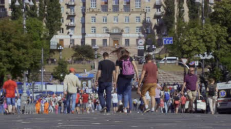 passerby : KYIV, UKRAINE - MAY 26, 2018 - People walking at the high street in the city