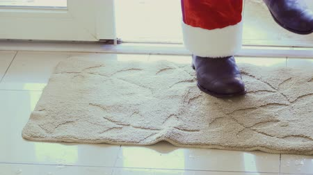 fur boots : Santa is coming inside house and shaking off his shoes at the small carpet