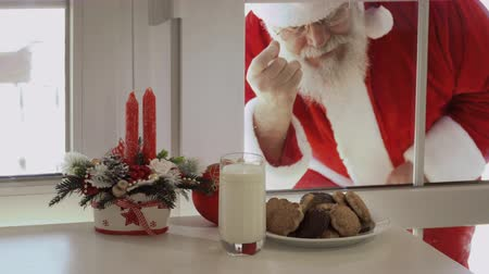 knocking : Santa Claus want to taste milk and cookies and look through a glass