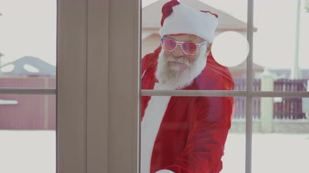 Войти : Santa Claus in funny sunglasses come in house