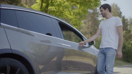 gentleman : Young man help his girlfriend to get out from car Stock Footage