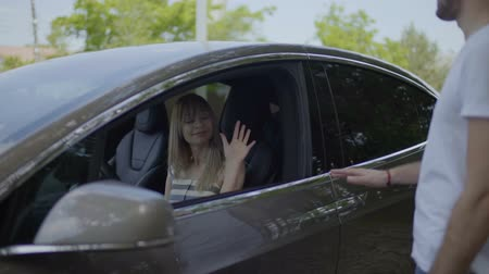 do widzenia : Young girl in car saying goodbye to her boyfriend and close car window