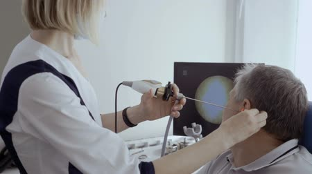 acoustical : Doctor examine ear of patient with ENT telescope