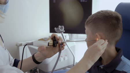 acoustical : Doctor check ear of child with ENT telescope