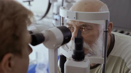 phoropter : Ophthalmologist check eyesight of senior man with modern equipment
