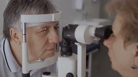 optyk : Doctor check the eyesight of adult man with modern equipment