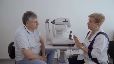 phoropter : Doctor talk with patient after checking his eyesight on the modern equipment