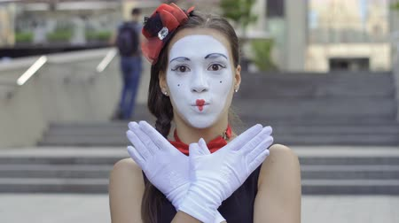 fool : Cute girl mime playing with hands on camera