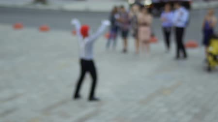 greasepaint : Mime at blurred background of fountain communicate with people