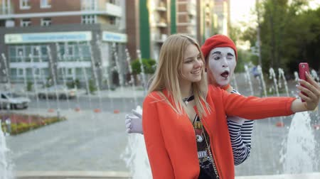 greasepaint : Young girl make selfie and mime at fountains background